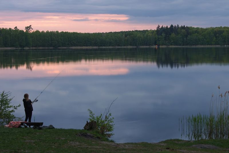 Lake View Poland Water Lake Tree Plant One Person Sky Rod Reflection Fishing Beauty In Nature Nature Real People Cloud - Sky Scenics - Nature Tranquility Activity Fishing Rod Tranquil Scene Outdoors