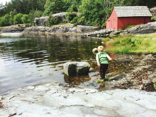 Throwing rocks in the sea Fjords Norway Hardanger Children Home Is Where The Art Is Play Sea Beach Boathouse