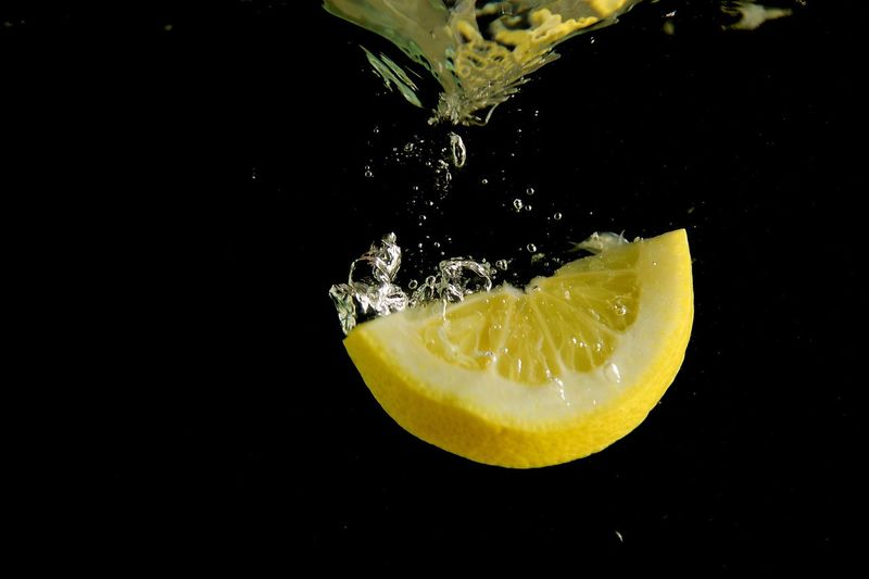 Citrus Splashing Studio Shot Freshness SLICE Motion Citrus Fruit Black Background Fruit Water Close-up Healthy Eating No People High-speed Photography Drink Day