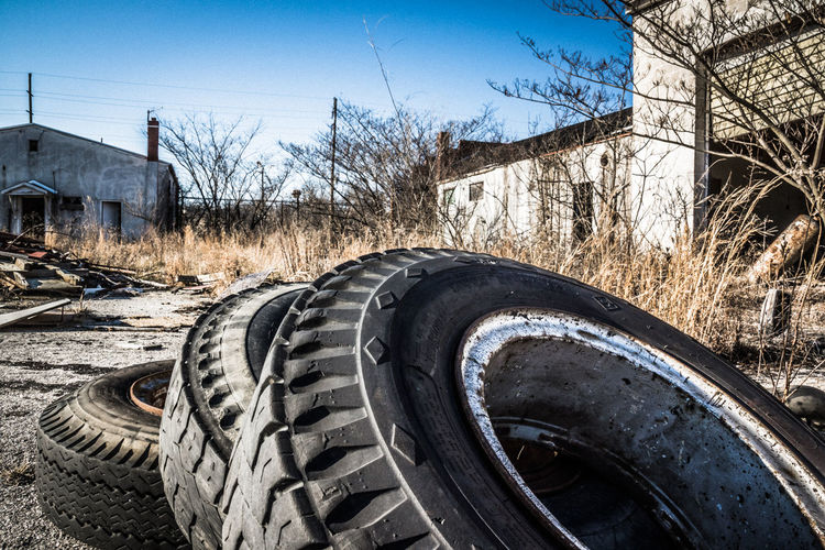 Abandoned Abandoned Buildings Abandoned Places Architecture Bare Tree Building Exterior Built Structure Day No People Outdoors Sky Tire Tree Wheel
