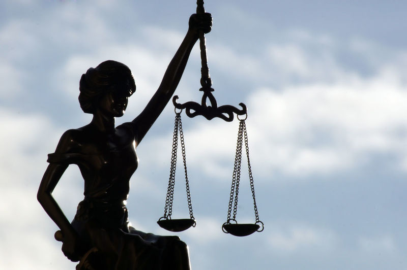 Lady Justice freed under the sky, symbol of justice Justice - Concept Justicia Law Lawyer Penalty Paragraph Handcuffs  Isolated Sky Sculpture Statue Symbol Crime Arrest Judge Judgement Legal Legal System Equilibrium Imprisonment Art And Craft Detention Decision Justice League