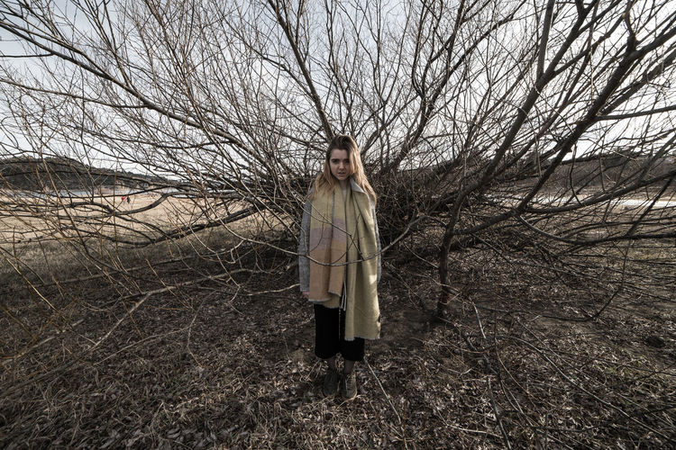 Young woman under the dark shadow of a tree with many branches that produces a scary aesthetic Aesthetics Afraid Alone Autumn Branches Dark Fear Field Holidays Nature Travel Tree Wheat Woman Adventure Countryside Female Forest Girl Landscape Mountains Scary Shadow Solitude Terror