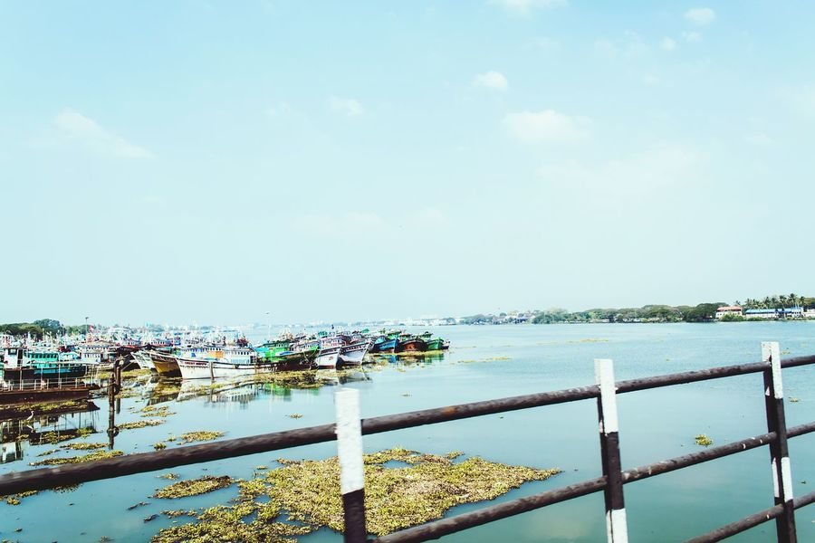 Vivid Candid Photography Sunny Day Water Boats Algie Blue Bridge Fence Sky Open Edit My Favorite Photo Backwaters Of Kerala Showing Imperfection Exploring
