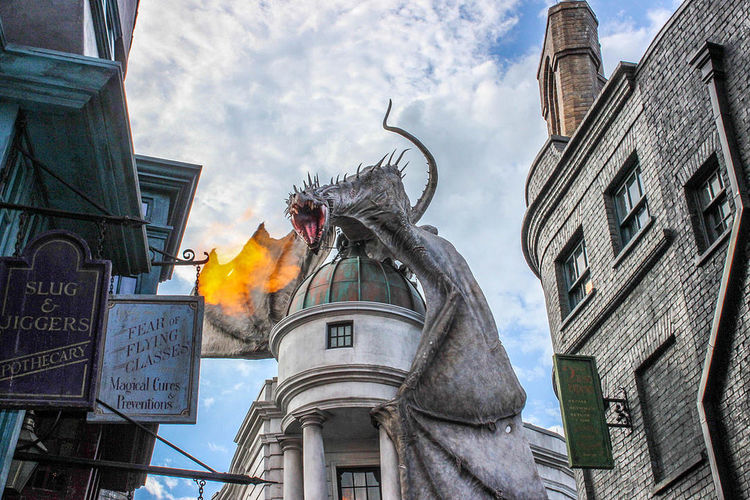 Architecture Bell Tower - Tower Building Exterior Built Structure Cloud - Sky Diagon Alley Dragon Famous Place Fire Firebreathing Florida Gringotts Harry Potter Low Angle View Nocturn Alley Spire  Tall - High Tourism Travel Destinations Universal Studios