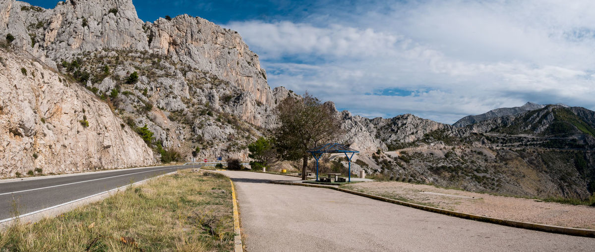 Scenic road on Makarska riviera in Croatia Transportation Road Mountain Sky Direction Nature Rock Day No People Environment Outdoors Nobody Empty Asphalt Scenics Way Croatia Makarska Riviera Europe Tree Travel Trip Destination Summer Drive Blue Rocky Traffic Panorama