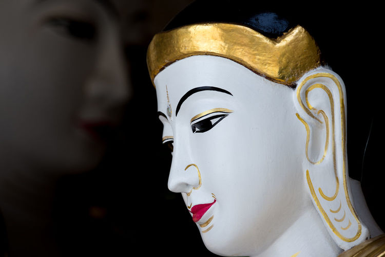 Sculpture of buddha in Myanmar which shows two side of buddha faces. Buddha Face Faith Respect Believe Buddha Head Buddhism Faces Focus On Foreground Foreground And Background Implying Meaningful  Myanmar Religion Religion And Beliefs Religions Sculpture Spirituality Statue