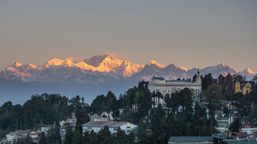 EyEmNewHere Himalayas India Morning Morning Light Mountain View Beauty In Nature City Cityscape Clear Sky Himalaya Mountain Mountain Peak Mountain Range Nature No People Outdoors Peaks Scenics - Nature Sikkim Sky Sunset Town TOWNSCAPE Tree
