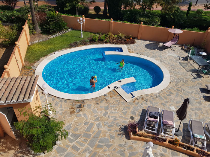 High angle view of swimming pool in yard