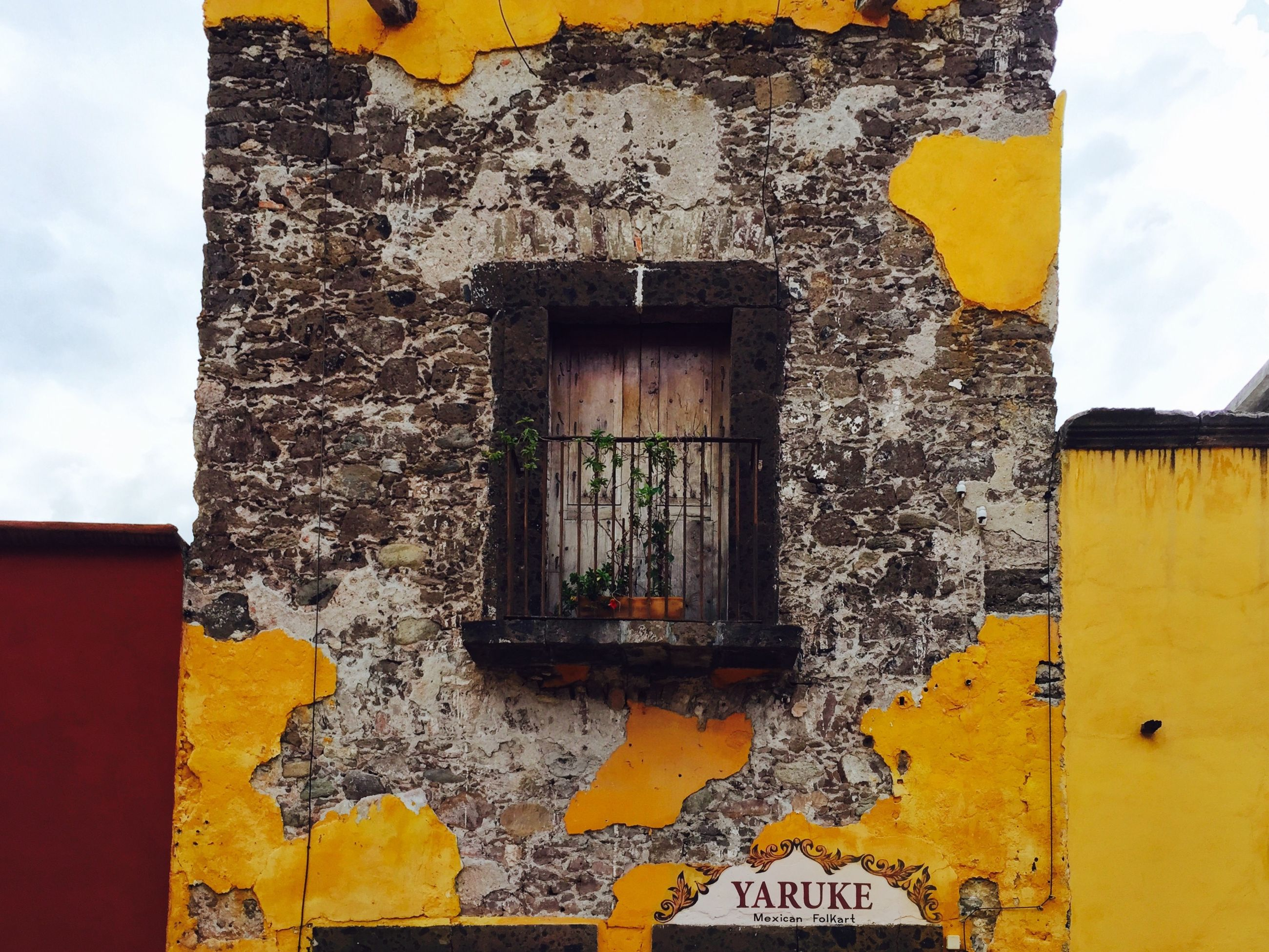 architecture, built structure, yellow, building exterior, weathered, old, house, door, wall - building feature, damaged, window, closed, abandoned, outdoors, residential structure, deterioration, day, no people, run-down, close-up