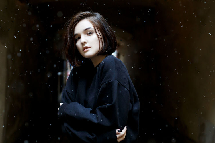 EyeEm EyeEm Gallery EyeEmNewHere Portrait Of A Woman Beautiful Woman Black Background Close-up Day Daydreaming Eye4photography  Lifestyles One Person Outdoors People Popular Photos Portrait Portrait Photography Real People Snow Standing Star - Space Young Adult Young Women