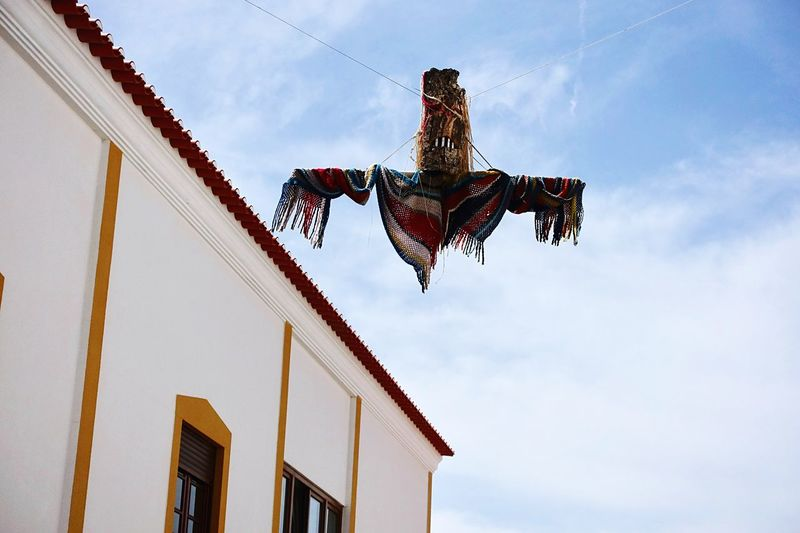 EyeEm Selects Strange bird... Mix Yourself A Good Time The Week On EyeEm Fun Sculpture Handcraft Low Angle View Architecture Built Structure Building Exterior Religion Sky Spirituality Hanging Day Cloud - Sky No People Statue Outdoors Portugal The Week On EyeEm
