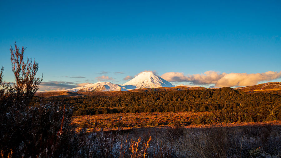 Panoramic view of volcanic landscape against blue sky