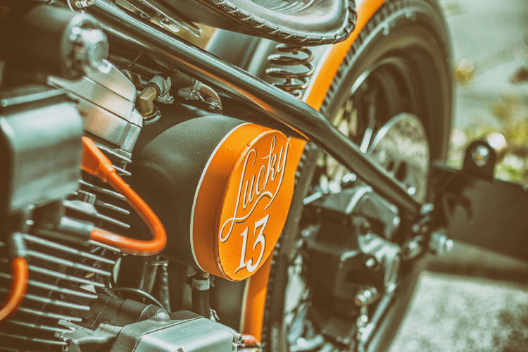 An old-school custom Harley bobber Cool Hardtail Harley Harley-Davidson Matt Motorcycle Old School Orange Retro Stylish Black Bobber Close-up Custom Lucky 13 Matt Black Pot Motorbike No People Outdoors Retro Styled