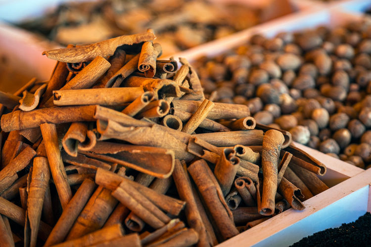 Close-up of a beautiful slide of cinnamon pods on a market showcase.