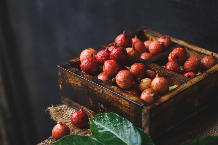 High Angle View Of Figs In Wooden Box