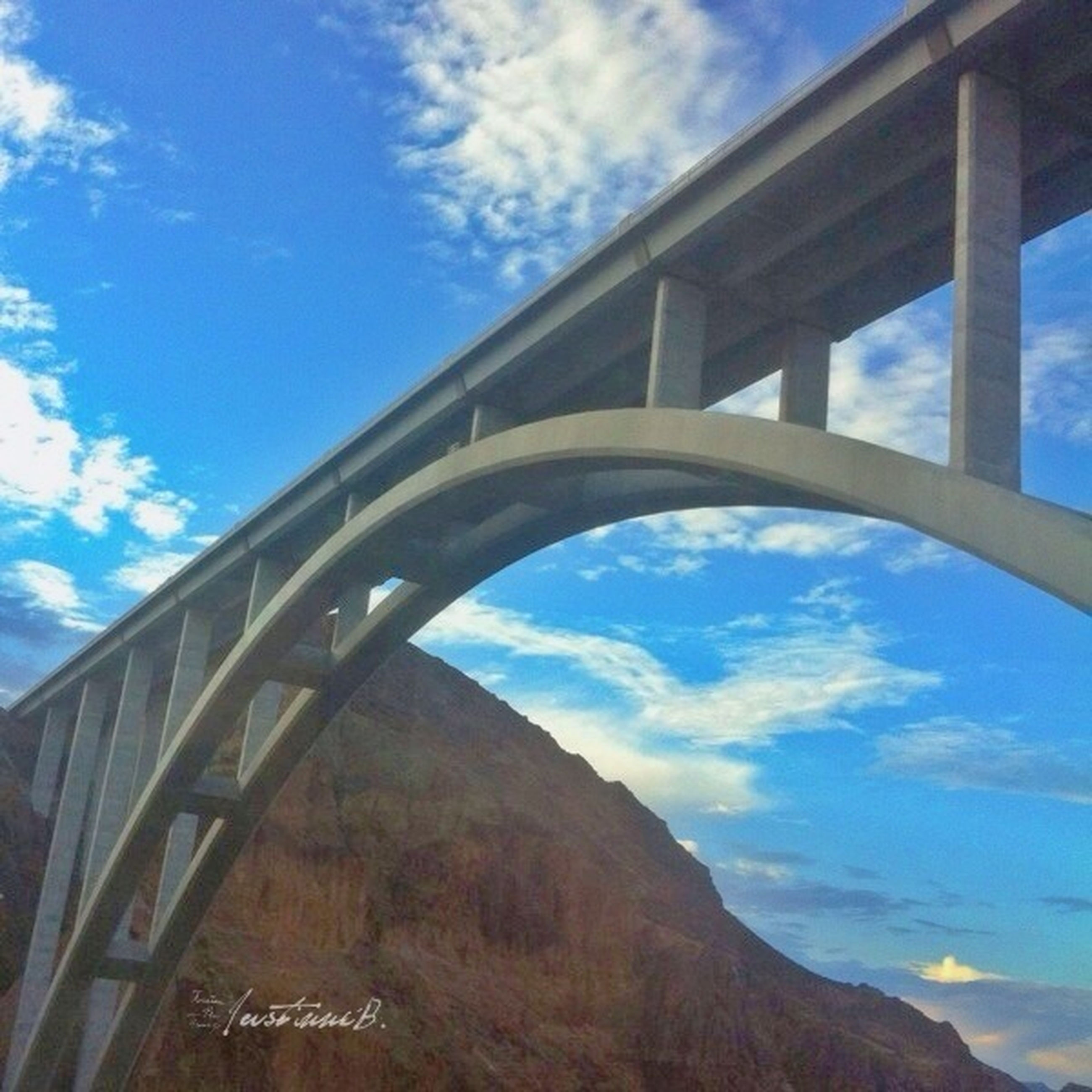 architecture, built structure, sky, connection, bridge - man made structure, low angle view, cloud - sky, engineering, cloud, bridge, blue, cloudy, day, no people, outdoors, river, arch, metal, building exterior, transportation