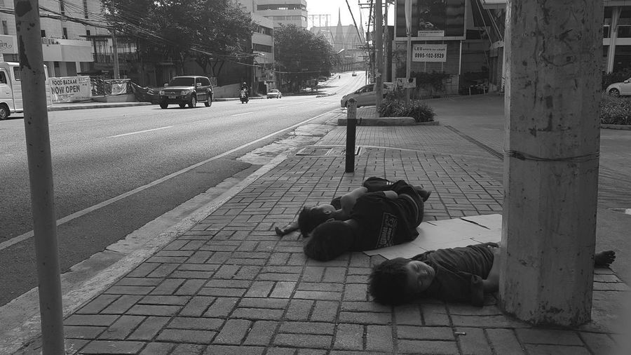 Cat lying down on street