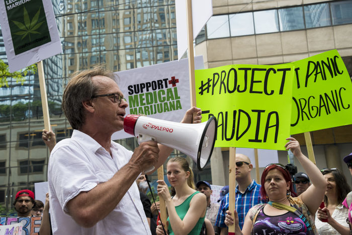 Marc Scott Emery leading the pot activists protest against Project Claudia outside Police Headquarters Activism Cannabis Casual Clothing Day Daytime Leader Leading Legalization Lifestyles Manifestation Marc Emery Marc Scott Emer Marihuana Marijuana Opposing Pot Prince Of Pot Project Claudia Protest Protesters Public Transportation SUPPORT Weed