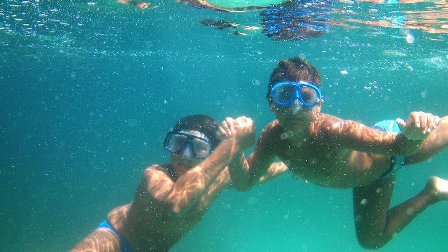 Young man swimming in sea