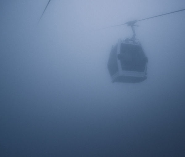 Gondola Cable Car Cold Temperature Copy Space Fog Frozen Low Angle View Mode Of Transportation No People Outdoors Transportation Winter Be Brave