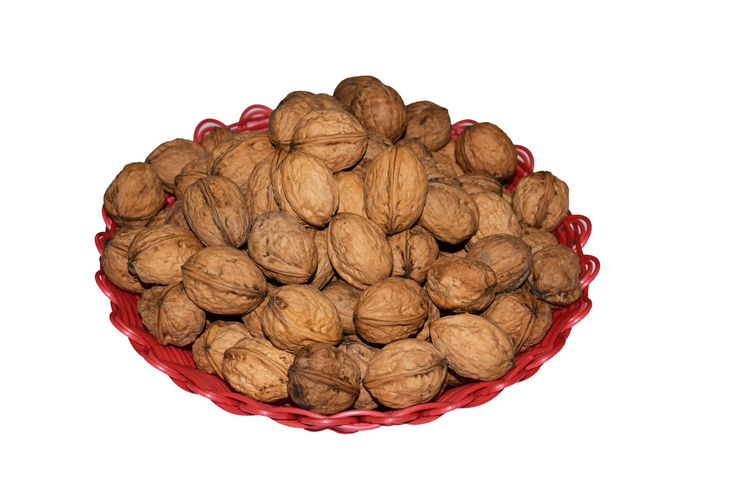Walnuts isolated on white background Walnuts Walnut Tree Hard Skin Clipping Path Autumn Eat Fruit White Background Basket Isolated Food And Drink Food Wellbeing Healthy Eating Cut Out Studio Shot White Background Nut - Food Nut Large Group Of Objects Still Life Freshness