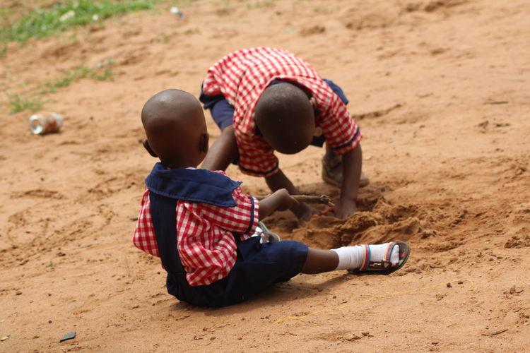Friends Digging Soil On Field