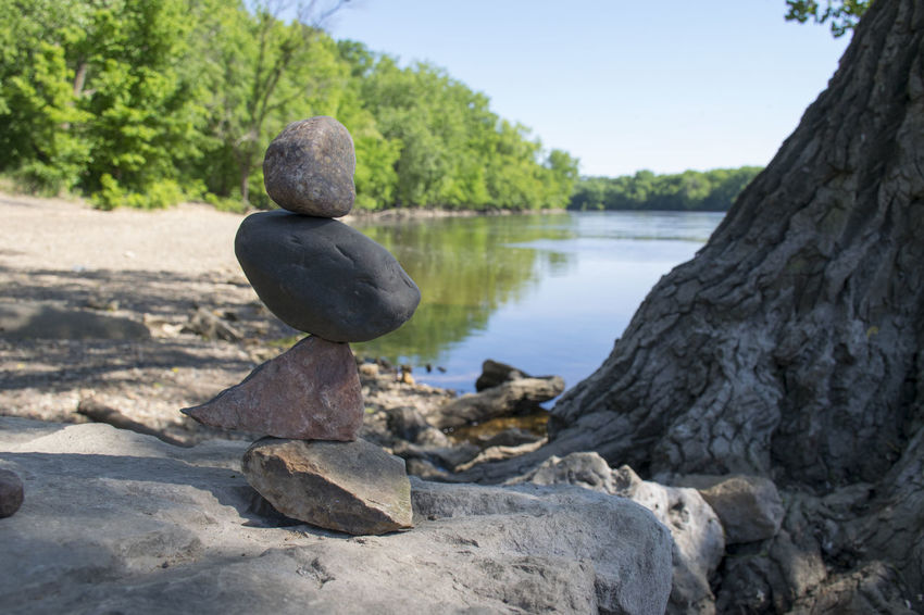 A Few Rocks Balancing on the Banks of the Mississippi River in Minneapolis, Minnesota. Beautiful Mississippi River Nature Nature Photography Precarious Rock Rock Stacking Balance Beauty In Nature Defying Gravity River Bank  River Rocks Rock Balancing Temporary