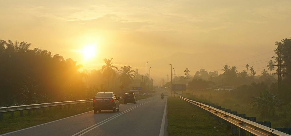 Social Issues Car Road Fog Agriculture Environment Sunset Rural Scene Street Travel Transportation Dawn Wet Forest Tree Nature No People Outdoors Extreme Weather Backgrounds