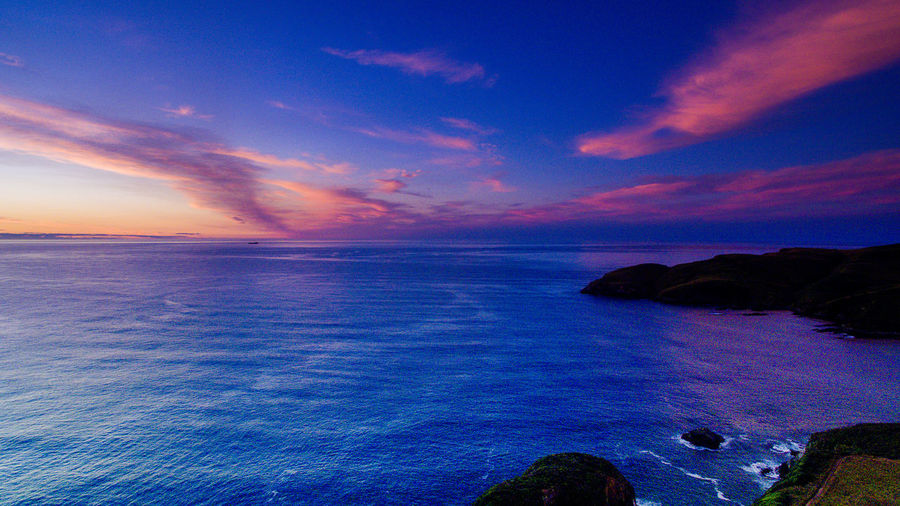 aerial drone shot over new zealand with water Drone  Sunset_collection Aerila Views Beach Beauty In Nature Blue Cloud - Sky Horizon Horizon Over Water Idyllic Land Nature No People Purple Rock Rock - Object Scenics - Nature Sea Sky Sunset Tranquil Scene Tranquility Water