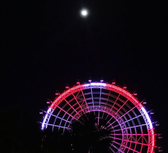 "Night Illuminated Arts Culture And Entertainment Celebration Low Angle View Ferris Wheel No People Amusement Park Clear Sky Outdoors Amusement Park Ride Moon Firework - Man Made Object Firework Display The ""eye"" of Orlando on a moonlit night Florida usa Minimalist Architecture The City Light"
