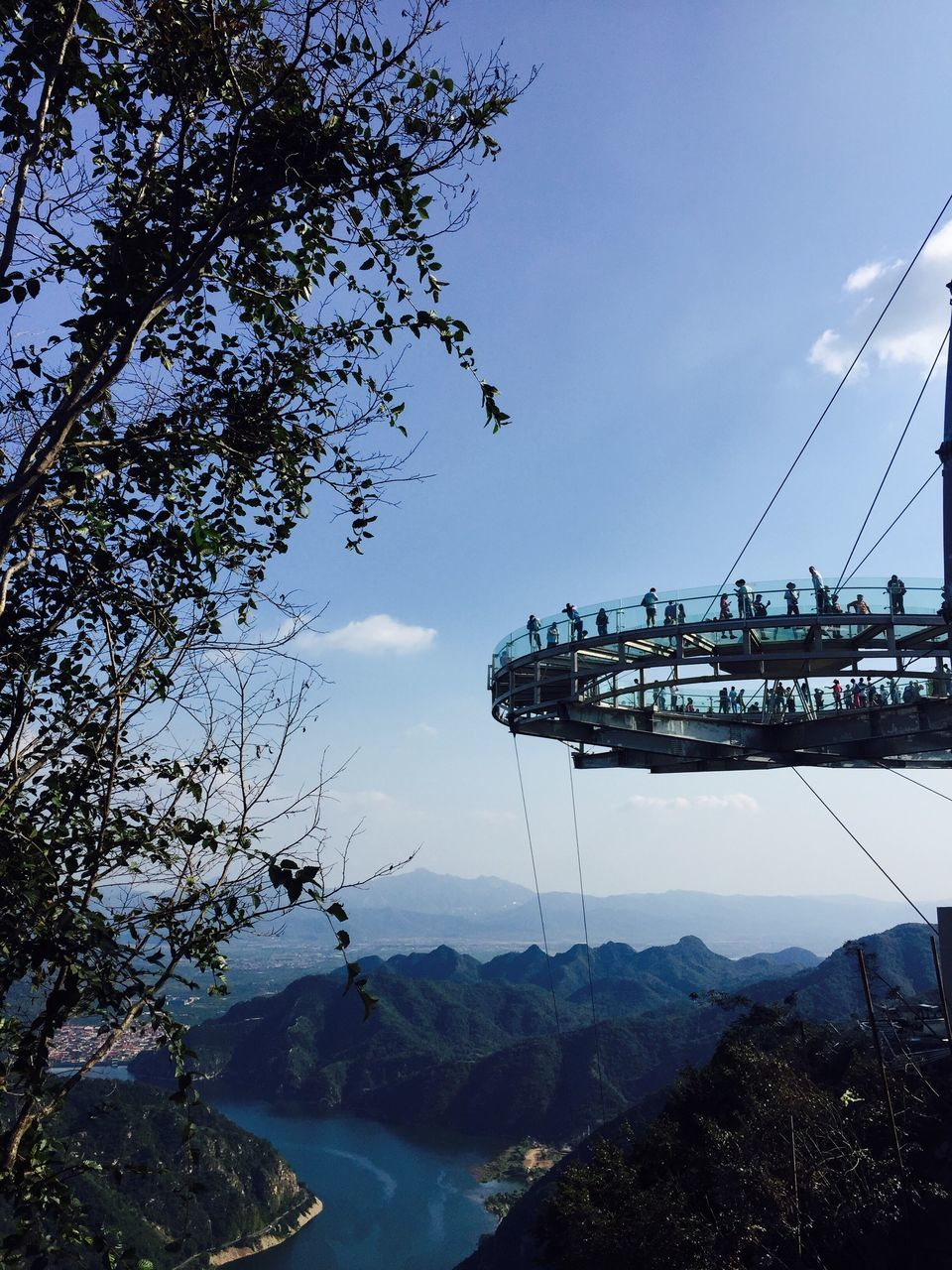 mountain, sky, tree, nature, transportation, mode of transport, beauty in nature, scenics, water, outdoors, tranquil scene, day, cloud - sky, no people, mountain range, tranquility, nautical vessel, overhead cable car, sea, architecture