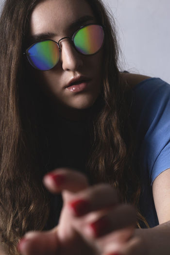 Close-up portrait of woman with vr glasses holding hands