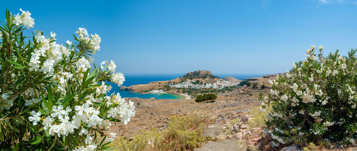 Panoramic view at lindos with ruins of ancient acropolis.. island of rhodes. greece.
