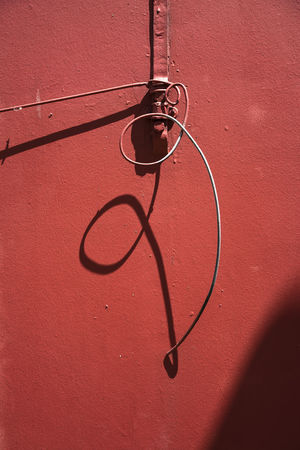 Cable Close-up Day Hanging Light And Shadow No People Outdoors Red Shadow Wall - Building Feature The Graphic City