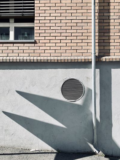Shadow of building on wall