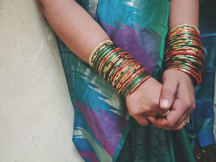 Handful of bangles Celebration Bangle Midsection Bracelet Sari Real People Bride Human Hand Cultures Indoors  One Person Human Body Part Close-up Women Life Events Day Adult Celebration Babyshower People Press For Progress The Portraitist - 2018 EyeEm Awards A New Perspective On Life International Women's Day 2019