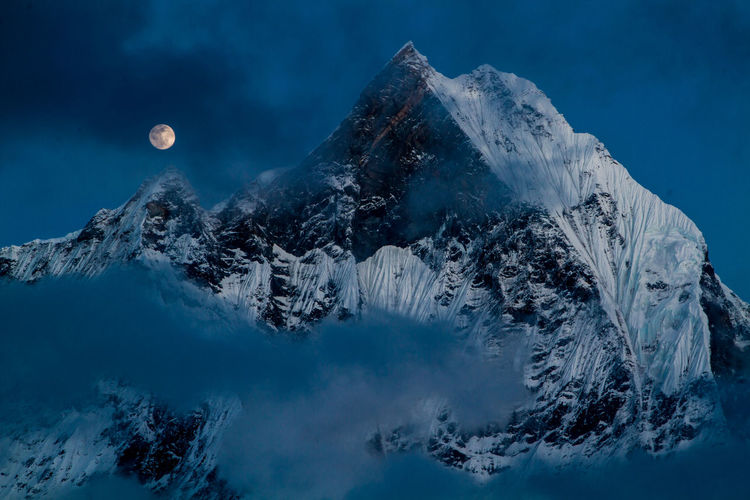 Machhapuchhre, also known as Fish Tail mountain, viewed from Annapurna base camp, during full moon night. Annapurna ASIA Beauty In Nature Blue Cold Temperature Full Moon Landscape Machhapuchhre Moon Mountain Mountain Peak Mountain Range Nature Nepal No People Outdoors Scenics Sky Snow Tranquility Travel Trekking Wanderlust Winter Camp