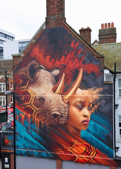 Looking to Tomorrow by Sonny Endangered Species Life London South Africa Africa Architecture Art Building Exterior Built Structure Croydon Street Art Day Future Mural One Person Outdoors People Rhino Savetherhino Sonny Street Art Totheboneproject Wildlife