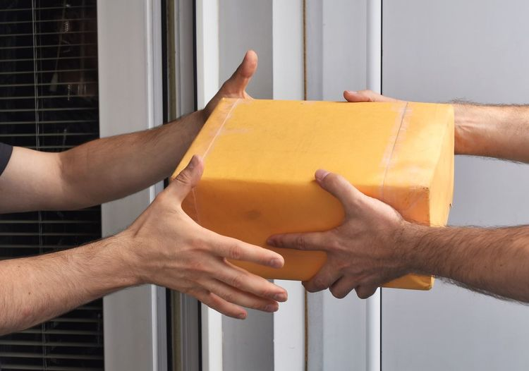 EyeEm Selects Package Delivery Human Hand Hand Human Body Part Real People Holding People Men Architecture Lifestyles Close-up Yellow Day Built Structure Outdoors Leisure Activity Finger Sunlight Unrecognizable Person