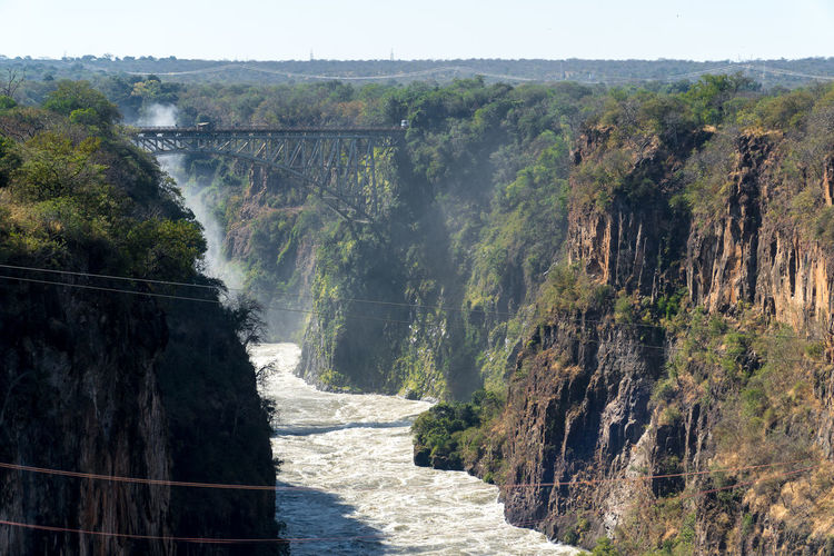 Tourist Attraction  UNESCO World Heritage Site Bridge Bridge - Man Made Structure Canyon Day Environment Famous Place Nature Rock Scenics - Nature Tranquil Scene Transportation Travel Destinations Victoria Falls Victoria Falls Bridge Water Zambezi River