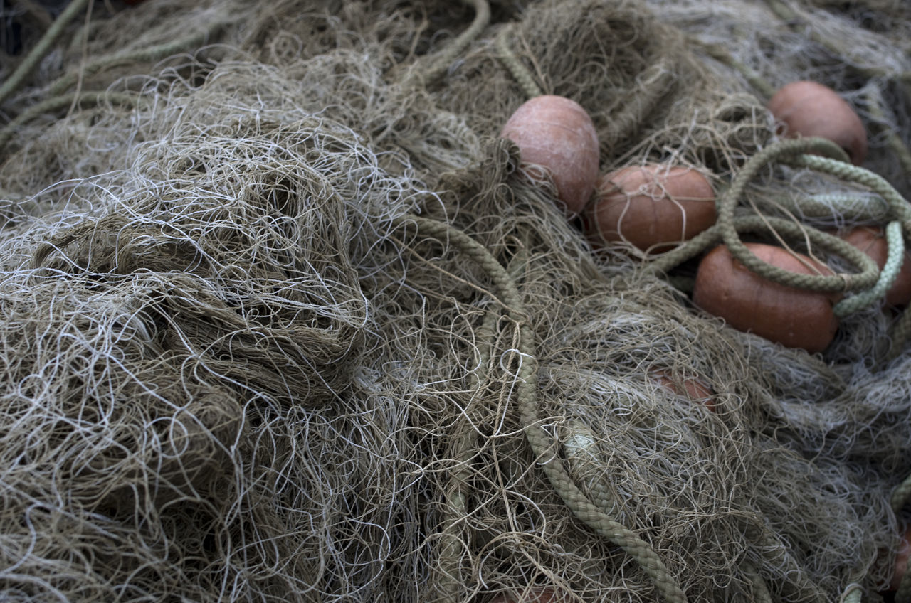 fishing net, high angle view, close-up, day, buoy, no people, fishing equipment, outdoors, fishing tackle, fragility, nature
