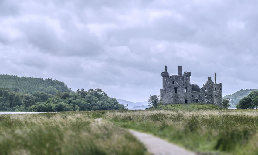 View of old ruin against cloudy sky