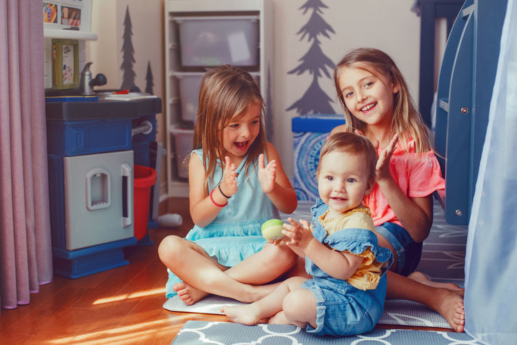 Happy siblings playing together at home