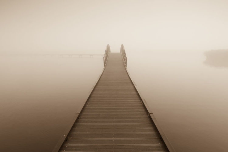 Jetty on river at dawn