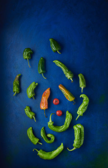 Directly above shot of chili peppers on blue background