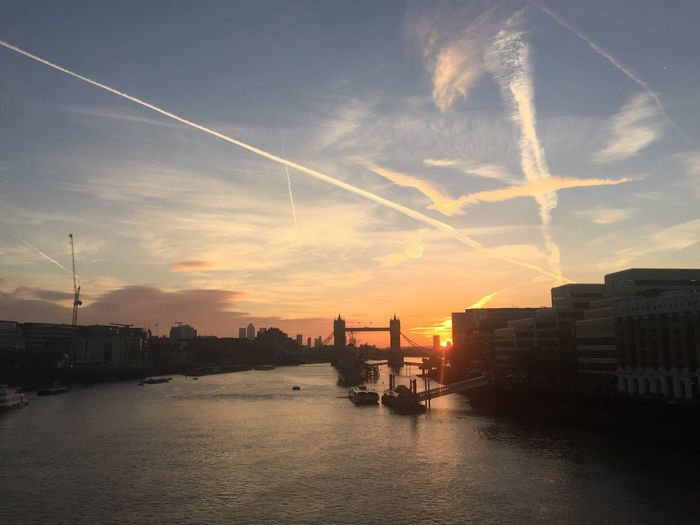 Mid distance over tower bridge over thames river against sky during sunset