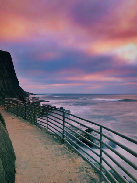 Sea Water Scenics Horizon Over Water Dramatic Sky Sunset Cloud - Sky Railing Beauty In Nature Tranquil Scene Nature Tranquility Outdoors Sky No People Multi Colored Beach Day