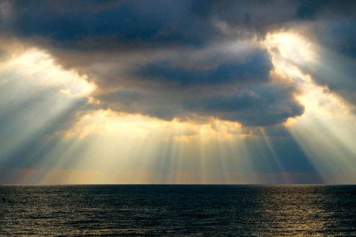 Dramatic Light Sun Rays Through The Clouds Sea Sky Water Cloud - Sky Horizon Over Water Horizon Beauty In Nature Sunbeam Sunlight Nature Scenics - Nature No People Tranquility Storm Dramatic Sky Waterfront Idyllic Tranquil Scene Outdoors Ominous