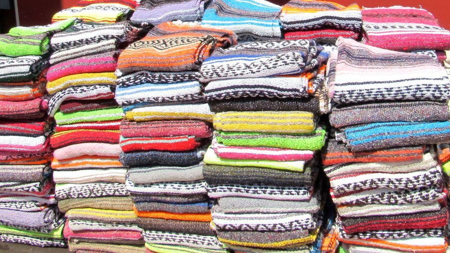 Mazatlan Mexico Mexican Blankets Multi Colored Backgrounds Market Full Frame Stack Choice Retail  Textile Variation Store Cloth Fabric Display Market Stall Souvenir Street Market For Sale Colorful Shop