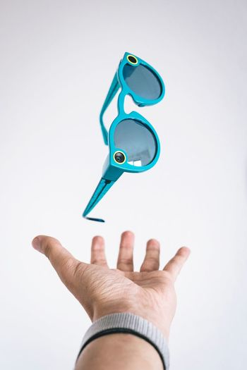 LOOK INTO THE FUTURE Telekinesis Magic Hovering Glases Sunglasses Spectacles Snapchat Holding Close-up Indoors  Personal Perspective Real People Copy Space Body Part Shape Men Unrecognizable Person Finger Human Finger Key